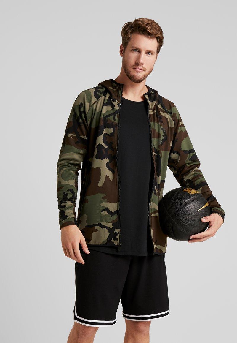 Nike Performance - SHOWTIME PRINT - Verryttelytakki - medium olive/black