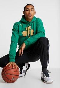 Nike Performance - NBA CITY EDITION BOSTON CELTICS LOGO HOODIE - Club wear - clover - 1