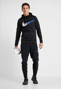 Nike Performance - Sweat à capuche - black - 1