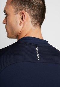 Nike Performance - M NK FZ FLC NPC - Training jacket - obsidian - 3