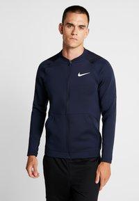 Nike Performance - M NK FZ FLC NPC - Training jacket - obsidian - 0