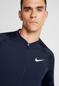 Nike Performance - M NK FZ FLC NPC - Training jacket - obsidian - 4