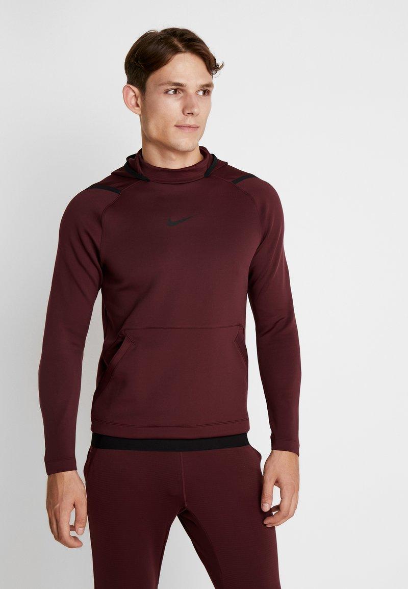 Nike Performance - Jersey con capucha - night maroon
