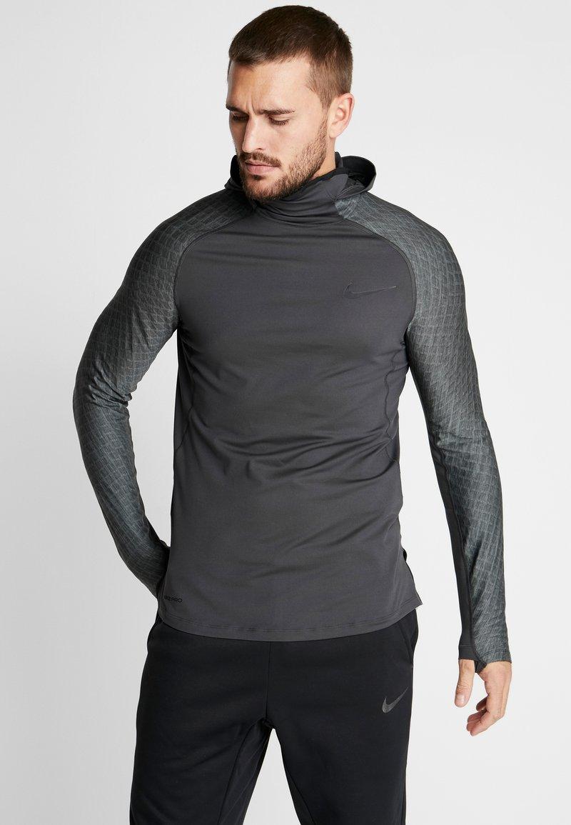 Nike Performance - UTILITY THRMA NVTY - Camiseta de deporte - dark smoke grey/black