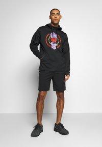 Nike Performance - M NK THRMA HD PO DVG - Hoodie - black - 1