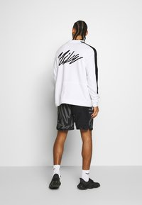 Nike Performance - M NK DRY TOP FLEECE PX - Felpa - white/black - 2