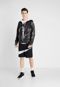 Nike Performance - SPOTLIGHT HOODIE FULL ZIP MARBLE - Training jacket - black/black - 1