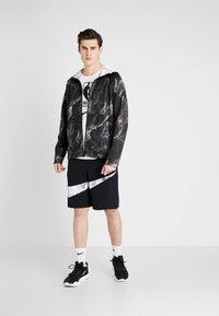 Nike Performance - SPOTLIGHT HOODIE FULL ZIP MARBLE - Veste de survêtement - black/black - 1