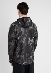 Nike Performance - SPOTLIGHT HOODIE FULL ZIP MARBLE - Training jacket - black/black