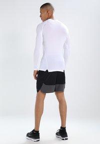 Nike Performance - PRO COMPRESSION - Maglietta intima - white/black - 2