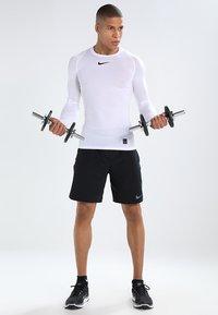 Nike Performance - PRO COMPRESSION - Maglietta intima - white/black - 1
