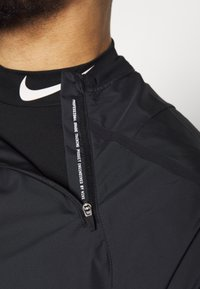 Nike Performance - M NK DRILL TOP NPC - Sports shirt - black/white - 4