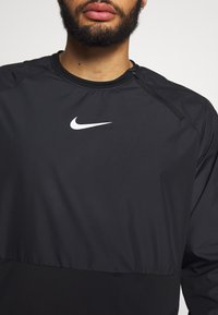 Nike Performance - M NK DRILL TOP NPC - Sports shirt - black/white - 6