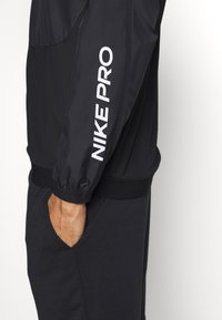Nike Performance - M NK DRILL TOP NPC - Sports shirt - black/white - 3