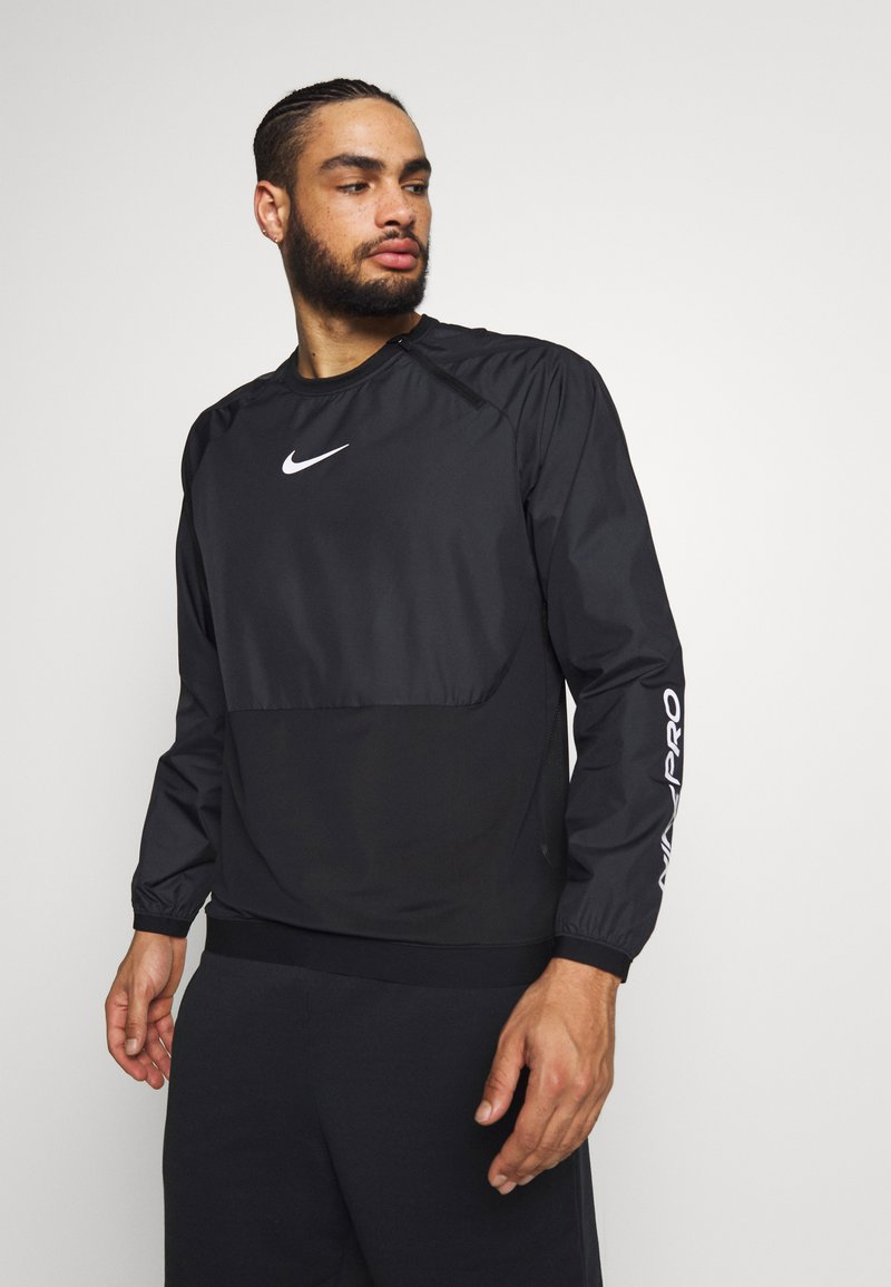 Nike Performance - M NK DRILL TOP NPC - Sports shirt - black/white