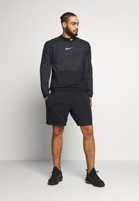 Nike Performance - M NK DRILL TOP NPC - Sports shirt - black/white - 1