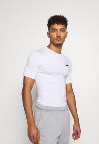 Nike Performance - TIGHT - T-shirts - white - 0