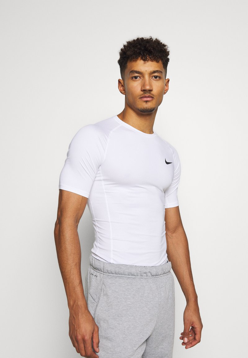 Nike Performance - TIGHT - T-shirts - white