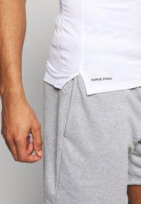 Nike Performance - TIGHT - T-shirts - white - 3