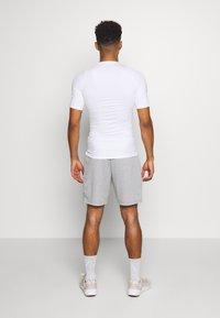 Nike Performance - TIGHT - T-shirts - white - 2