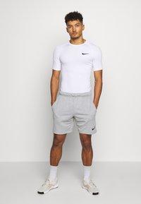 Nike Performance - TIGHT - T-shirts - white - 1