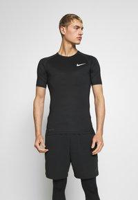 Nike Performance - TIGHT - Camiseta básica - black - 0