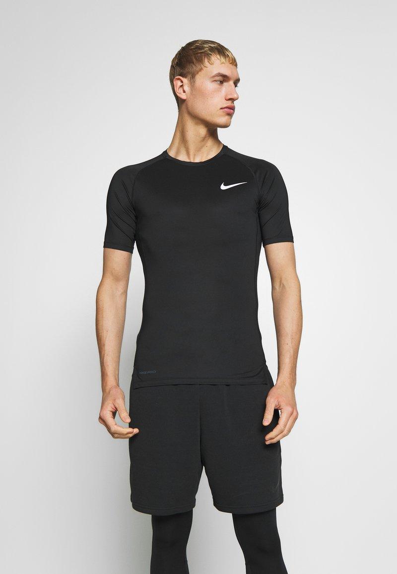 Nike Performance - TIGHT - Camiseta básica - black