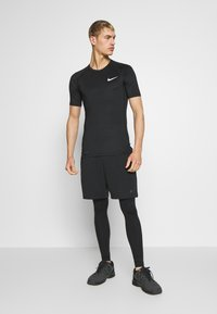 Nike Performance - TIGHT - Camiseta básica - black - 1
