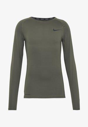 TIGHT - Sports shirt - cargo khaki/black