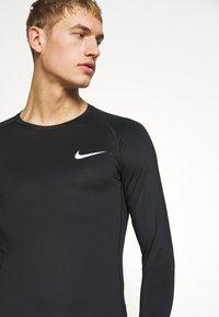 Nike Performance - Tekninen urheilupaita - black - 3