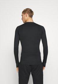 Nike Performance - Tekninen urheilupaita - black - 2