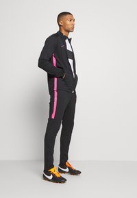 Nike Performance - DRY ACADEMY SUIT - Tracksuit - black/hyper pink - 1