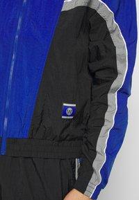 Nike Performance - NBA GOLDEN STATE WARRIORS CITY EDITION TRACKSUIT - Trainingspak - black/rush blue/dark steel grey - 8