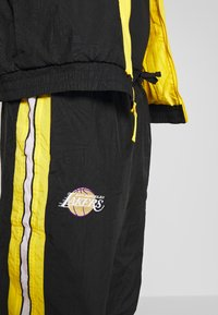 Nike Performance - NBA LOS ANGELES LAKERS CITY EDITION - Tuta - black/amarillo/white - 9