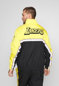 Nike Performance - NBA LOS ANGELES LAKERS CITY EDITION - Tuta - black/amarillo/white - 2