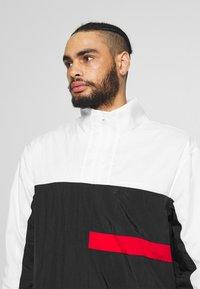 Nike Performance - FLIGHT TRACKSUIT - Dres - black/white/university red - 7