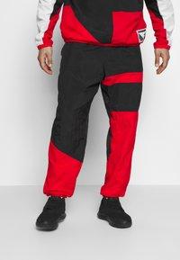Nike Performance - FLIGHT TRACKSUIT - Dres - black/white/university red - 3