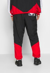 Nike Performance - FLIGHT TRACKSUIT - Dres - black/white/university red - 5