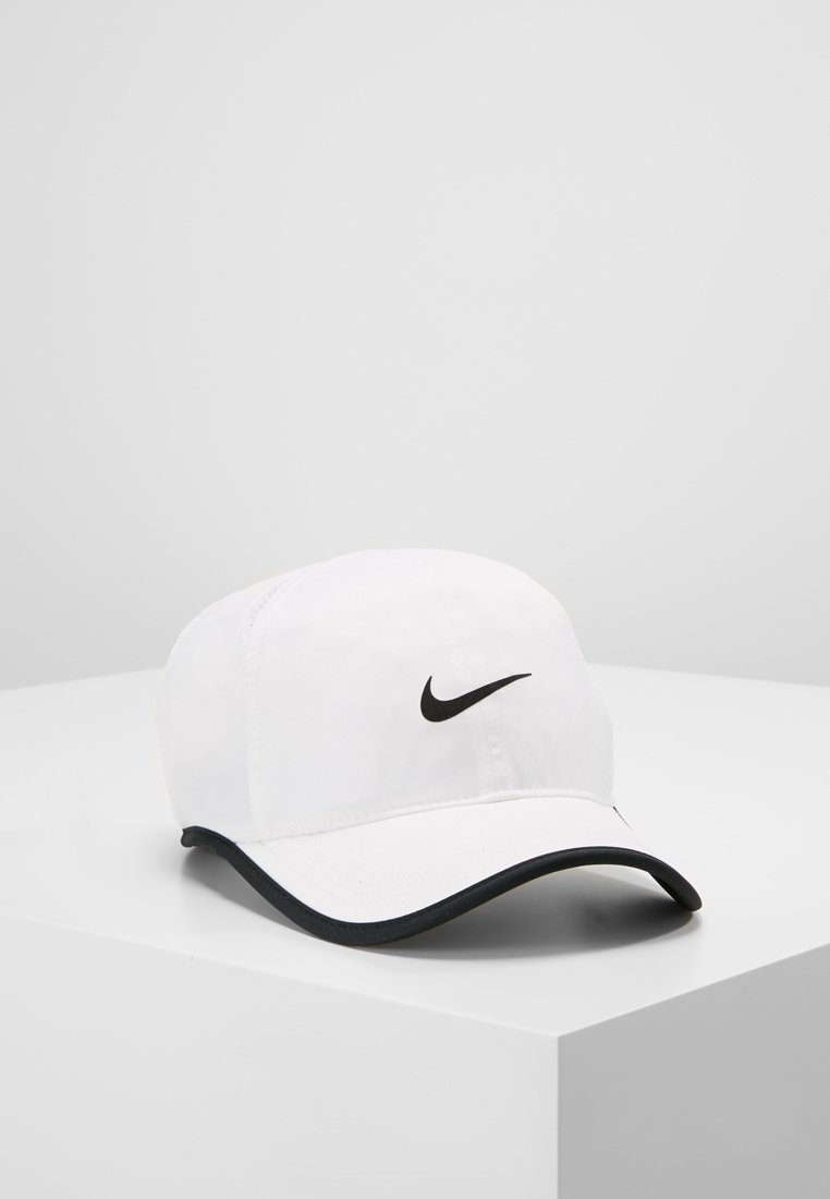 Nike Performance - FEATHERLIGHT - Keps - white/black