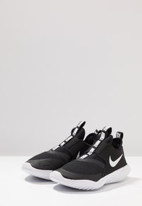 Nike Performance - FLEX RUNNER - Competition running shoes - black/white