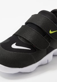 Nike Performance - FREE RN - Neutral running shoes - black/white/anthracite/volt - 2