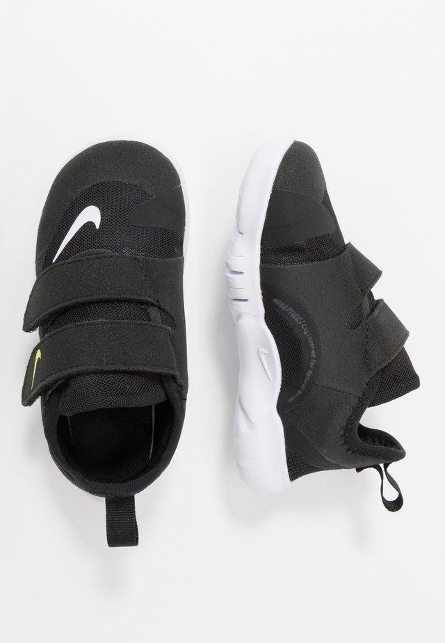 FREE RN - Neutral running shoes - black/white/anthracite/volt