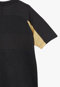 Nike Performance - DRY ACADEMY  - Sports shirt - black/white/gold - 2