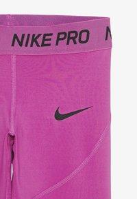 Nike Performance - 3/4 sports trousers - active fuchsia/black - 3