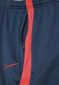 Nike Performance - DRY ACADEMY PANT - Tracksuit bottoms - valerian blue/laser crimson - 4