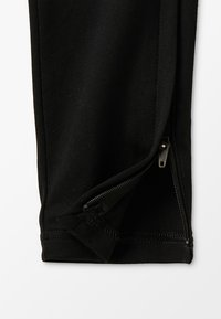 Nike Performance - DRY ACADEMY PANT - Tracksuit bottoms - black/ember glow - 3