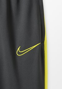 Nike Performance - DRY ACADEMY PANT - Tracksuit bottoms - anthracite/opti yellow - 4