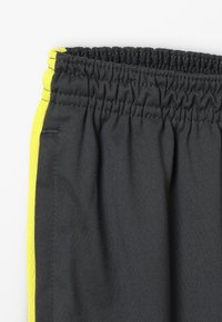 Nike Performance - DRY ACADEMY PANT - Tracksuit bottoms - anthracite/opti yellow - 2