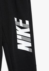 Nike Performance - DRY PANT - Træningsbukser - black/white - 3