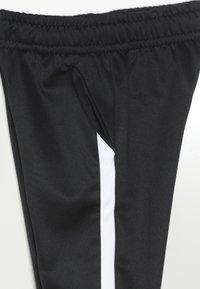 Nike Performance - THERMA PANT - Pantaloni sportivi - black/white - 4